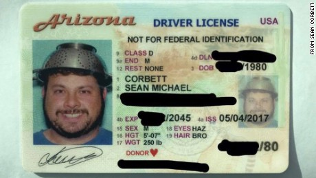 An Arizona man wears a pasta strainer on his head in his driver's license photo.