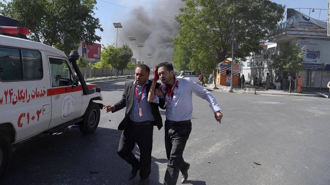 "A wounded man, right, receives assistance after a bomb attack in Kabul, Afghanistan, on Wednesday, May 31. A suicide bomb <a href=""http://www.cnn.com/2017/05/31/asia/kabul-explosion-hits-diplomatic-area/"" target=""_blank"">ripped through a secure area of Kabul</a> at the height of the morning rush hour, killing at least 90 people and wounding 400, Afghan officials said."