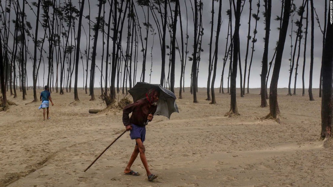 "A villager walks to a cyclone shelter in Cox's Bazar, a town in Bangladesh, on Tuesday, May 30. Nearly 1 million people evacuated low-lying areas as <a href=""http://www.cnn.com/2017/05/29/asia/bangladesh-cyclone-mora/"" target=""_blank"">Cyclone Mora</a> pounded the country's southern coastline."