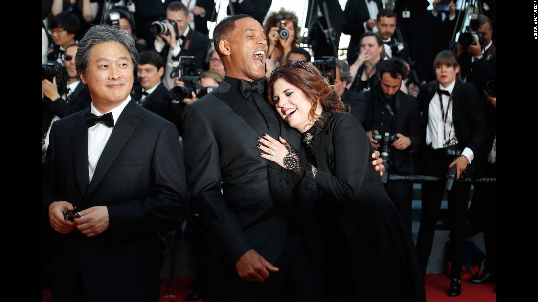 From left, director Park Chan-wook, actor Will Smith and director Maren Ade walk the red carpet at the Cannes Film Festival in France on Sunday, May 28. They were all on the festival's jury this year.