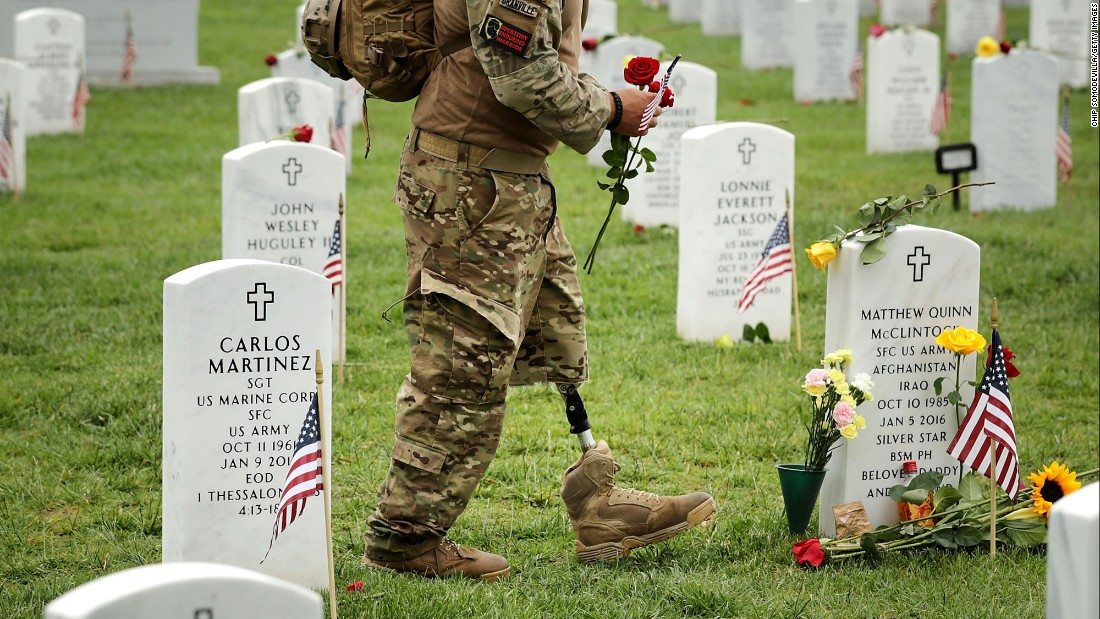 Veteran Earl Granville walks through Arlington National Cemetery on Memorial Day. Granville lost his left leg to a roadside bomb in Afghanistan in 2007.