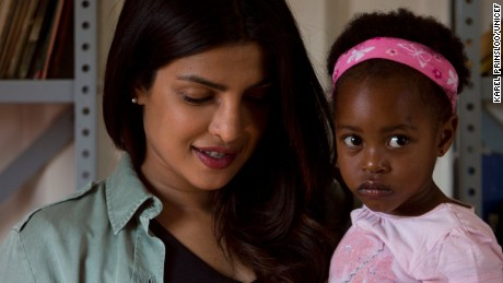 On 7 May 2017 in South Africa, UNICEF Goodwill Ambassador Priyanka Chopra reads a story to 3-year-old Sindiduringa, in her arms, while an older girl listens, in the childrenÕs library at the Isibindi Safe Park in Soweto Township, in the city of Johannesburg. Safe Parks Ð established through the UNICEF-supported Isibindi project Ð are designated community areas where Child and Youth Care Workers engage children in constructive, age-appropriate educational and recreational activities after school. The community-based programme was developed by the National Association of Child Care Workers to help respond to the needs of orphans and other vulnerable children. Through the Isibindi programme, local community members are trained as Child and Youth Care Workers to identify and provide support for vulnerable families to ensure that at-risk children have access to essential services. These services can include accompanying children to school, a health clinic or the hospital if needed; as well as helping children obtain important official documents, such as birth certificates; as well as government grants; psychosocial support; and counselling. Goodwill Ambassador Chopra is in the country to raise funds on behalf of vulnerable children and to visit UNICEF-supported programme sites.riate educational and