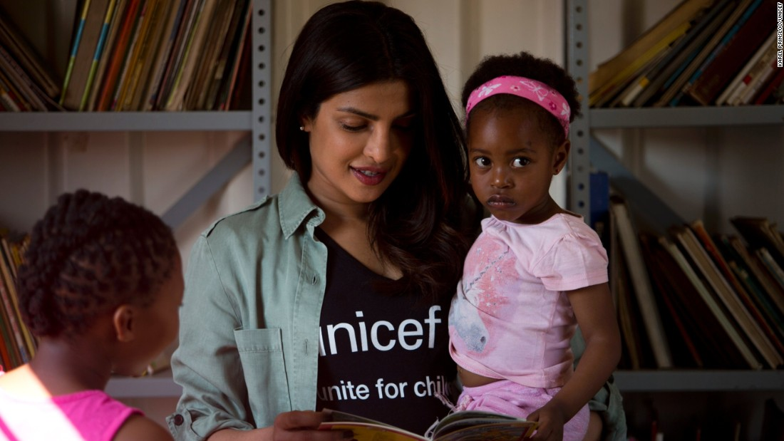 On May 7, 2017 in South Africa, UNICEF Goodwill Ambassador Priyanka Chopra reads a story to 3-year-old Sindiduringa, in her arms, while an older girl listens, in the children's library at the Isibindi Safe Park in Soweto Township, in the city of Johannesburg. Photo/Unicef/Karel Prinsloo