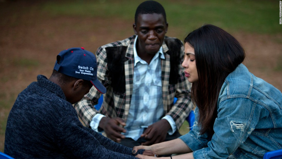 On May 4, 2017 in Zimbabwe, UNICEF Goodwill Ambassador Priyanka Chopra (right), accompanied by a young man, comforts another youth living with HIV, at the AFRICAID support centre in Avondale, a suburb of Harare, the capital. AFRICAID provides specialized services in support of the Government's National Action Plan for Orphans and Vulnerable Children.