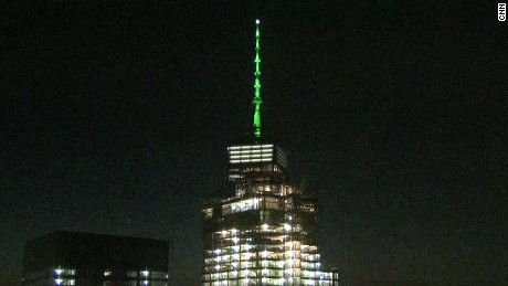 Buildings light up green in solidarity with Paris climate accord