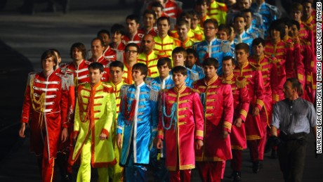 LONDON, ENGLAND - JULY 27:  Performers dressed in the suits worn by The Beatles on the cover of their album 'Sgt. Pepper's Lonely Hearts Club Band'   during the Opening Ceremony of the London 2012 Olympic Games at the Olympic Stadium on July 27, 2012 in London, England.  (Photo by Laurence Griffiths/Getty Images)
