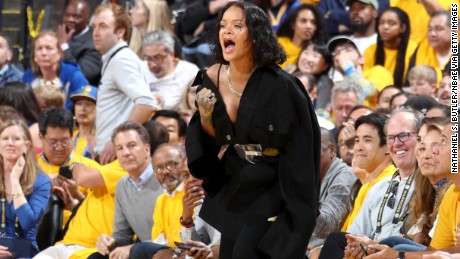 Rihanna cheers from the side line during the game of the Golden State Warriors and the Cleveland Cavaliers in Game One of the 2017 NBA Finals on June 1 in Oakland, California.
