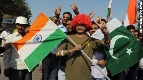 An Indian fan poses with  flags of India and Pakistan outside the Sardar Patel Gujarat Stadium, on December 28, 2012.