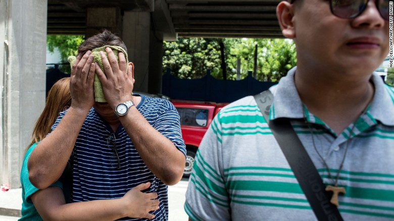 Relatives of a victim cry outside the Resorts World Hotel in Manila on June 2, 2017.