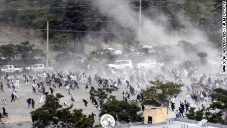 People run for safety after an explosion during the June 3 funeral for a man killed a day earlier in anti-government protests.