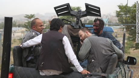 Injured men gather in the back of a pickup truck after the Saturday blasts.