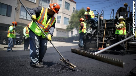 SAN FRANCISCO, CA - MAY 15:  San Francisco Department of Public Works workers lay asphalt on a street on May 15, 2017 in San Francisco, California.  San Francisco mayor Ed Lee announced a two-year $90 million street repair project to repave the city's aging roads.  (Photo by Justin Sullivan/Getty Images)