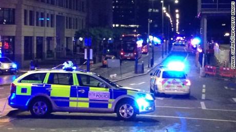 "A photograph taken on a mobile phone shows British police cars blocking the entrance to London Bridge, in central London on June 3, 2017, following an incident on the bridge.  Police are dealing with a ""major incident"" on London Bridge, Transport for London said on Saturday, after witnesses reported seeing a van mounting the pavement and hitting pedestrians. / AFP PHOTO / Daniel SORABJI        (Photo credit should read DANIEL SORABJI/AFP/Getty Images)"