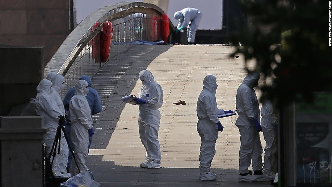 Forensic officers work at the scene of a terror attack at London Bridge in London on Sunday, June 4. At least seven people were killed in attacks late Saturday as a van mowed down pedestrians on London Bridge before attackers then stabbed victims at nearby Borough Market.