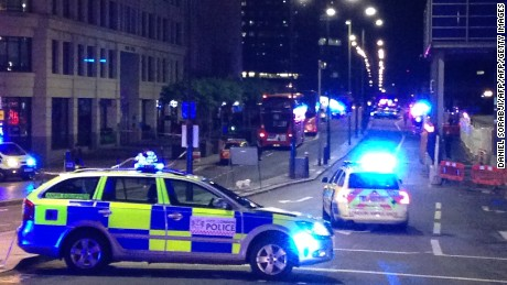 "TOPSHOT - A photograph taken on a mobile phone shows British police cars blocking the entrance to London Bridge, in central London on June 3, 2017, following an incident on the bridge.  Police are dealing with a ""major incident"" on London Bridge, Transport for London said on Saturday, after witnesses reported seeing a van mounting the pavement and hitting pedestrians. / AFP PHOTO / Daniel SORABJI        (Photo credit should read DANIEL SORABJI/AFP/Getty Images)"