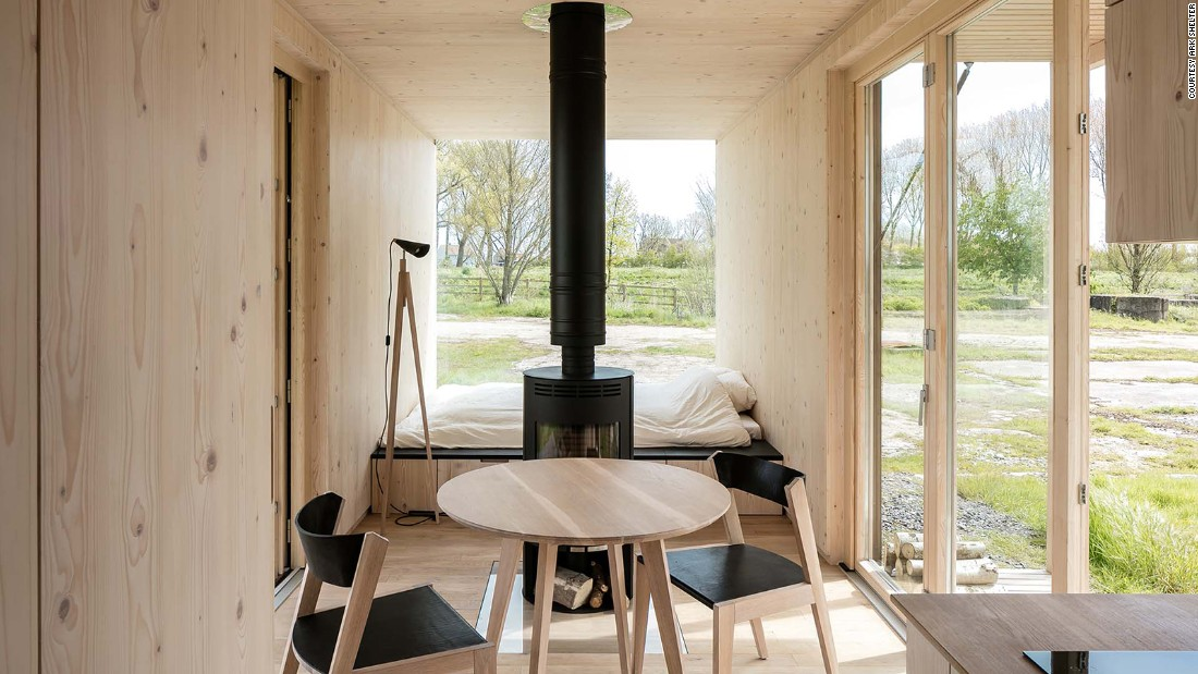 This prefab cabin is designed to blend into any terrain, and relies only on rainwater and wind for power. Its floor-to-ceiling windows bring in plenty of natural light to the tiny home, and while its plywood interiors may be sparse, the hut is delivered fully furnished.