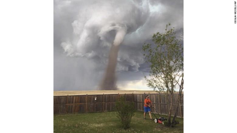 170605122904-canada-tornado-mowing-lawn-
