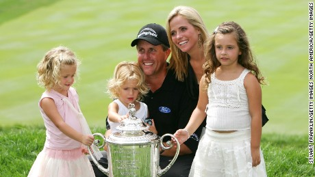 SPRINGFIELD, NJ - AUGUST 15:  Phil Mickelson is surrounded by his wife, Amy (back), daughters Sophia (L), Evan (C) and Amanda (R) after winning the 2005 PGA Championship with a 4-under par 276 on August 15, 2005 in Springfield, New Jersey.  (Photo by Stuart Franklin/Getty Images)
