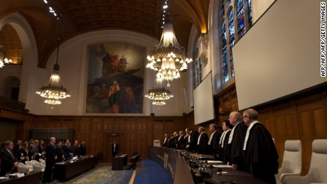 International Court of Justice (ICJ) judges preside over the verdict hearing in The Hague on December 13, 2013 on provisional measures over an island territorial dispute between Costa Rica and Nicaragua. The ICJ ruled against a request by Nicaragua to halt Costa Rica's construction of a road parallel to the San Juan river which marks the natural border between the two countries. AFP PHOTO / NICOLAS DELAUNAY        (Photo credit should read NICOLAS DELAUNAY/AFP/Getty Images)