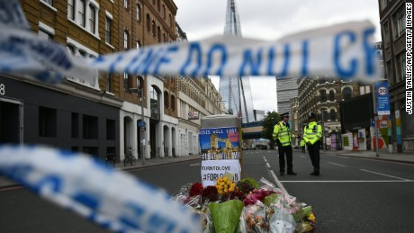 Police officers stand on duty at a cordon near Borough Market in London on June 5, 2017, as investigations continue following the June 3 terror attack.