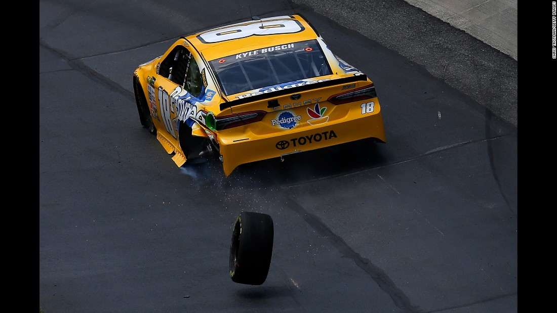 NASCAR driver Kyle Busch loses a tire as he exits pit road during the Cup Series race in Dover, Delaware, on Sunday, June 4.