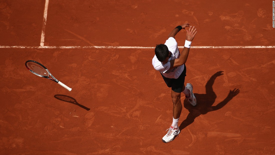 Novak Djokovic throws his racket in frustration during a second-round match at the French Open on Wednesday, May 31. He still won the match in straight sets.