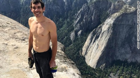 "This Saturday, June 3, 2017, photo provided by National Geographic shows Alex Honnold atop El Capitan in Yosemite National Park, Calif., after he became the first person to climb alone to the top of the massive granite wall without ropes or safety gear. National Geographic recorded Honnold's historic ascent, saying the 31-year-old completed the ""free solo"" climb Saturday in nearly four hours. The event was documented for an upcoming National Geographic feature film and magazine story. (Jimmy Chin/National Geographic via AP)"