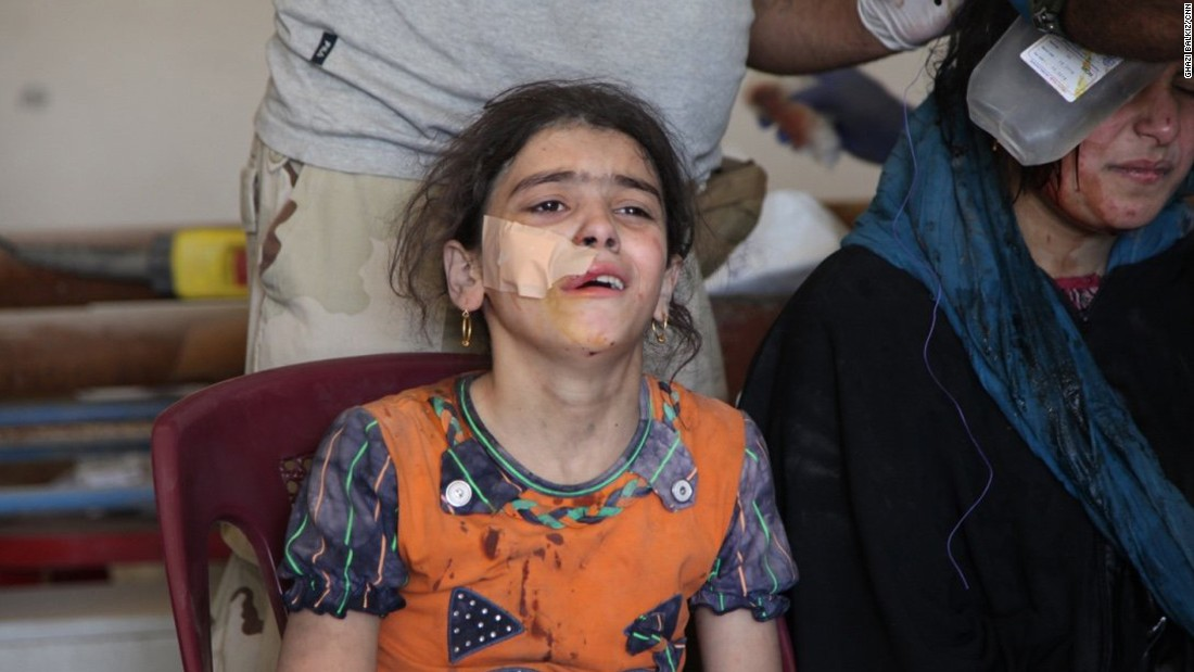 Ten-year-old Mariam Salim cries as she is treated at a makeshift clinic in western Mosul. She was trying to make a run for it with her family on June 4, 2017, when their house collapsed from an explosion. Most in her family are buried under the rubble of what was their home.