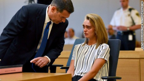 Defense attorney Joseph Cataldo talks to his client, Michelle Carter, in court.