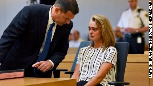 Defense attorney Joseph Cataldo talks to Michelle Carter in court.