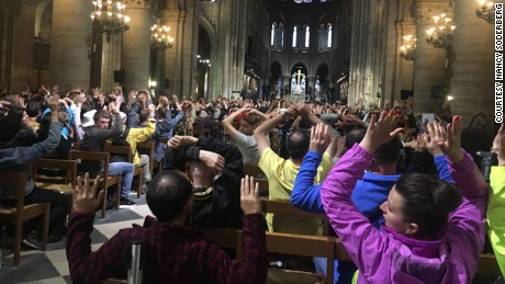 Police asked visitors to put their hands in the air during the June 6 incident at Notre-Dame Cathedral in Paris, social media users said.