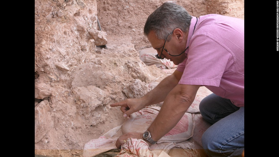 Jean-Jacques Hublin is pictured when he first saw the new finds at Jebel Irhoud  in Morocco. He is pointing to the crushed human skull.