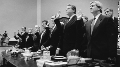 Tobacco executives are sworn in before congressional hearing.