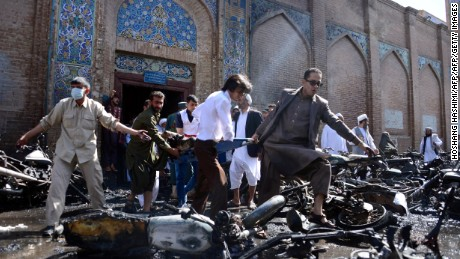 Afghan volunteers carry victims at the scene of a motorcycle bomb explosion in front of the Jami Mosque in Herat on June 6, 2017.   A motorcycle bomb exploded near the Grand Mosque in the western city of Herat, killing seven people and wounding 16 according to the interior ministry. / AFP PHOTO / HOSHANG HASHIMI        (Photo credit should read HOSHANG HASHIMI/AFP/Getty Images)