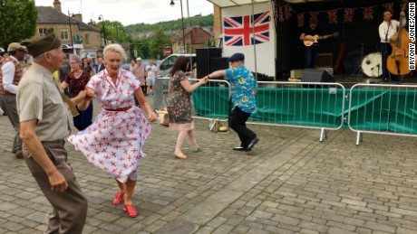 "People dance to swing music at Batley's Vintage Day. Shop owner Bal Singh planned to vote for the Conservatives, but is having second thoughts. ""I was very impressed with Theresa May, but all those u-turns she does undermine her appearance as a strong leader."""