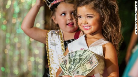 "Kailia Deliz, 5, wins the Ventura County ""Summer Fun"" Beauty Pageant.  A veteran at age 5, Kailia won every category in her age group, as well as High Point Scorer for the entire pageant, a $500 prize."