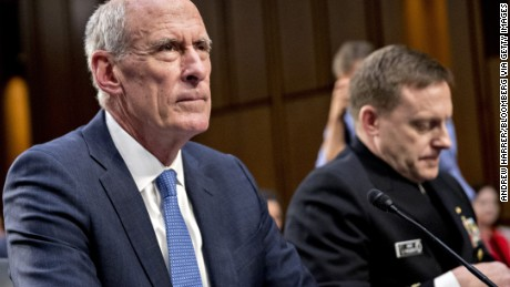 Dan Coats, director of national intelligence, left, and Michael Rogers, director of the National Security Agency (NSA), wait to begin a Senate Intelligence Committee  on Wednesday. Photographer: Andrew Harrer/Bloomberg via Getty Images