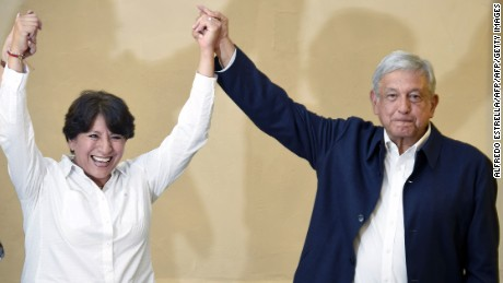 Delfina Gomez (L), Mexico state gubernatorial candidate for the National Regeneration Movement (MORENA), and the president of the party Andres Manuel Lopez Obrador, smile at the crowd after giving a message to the media in Mexico City on June 6, 2017.  The candidate and her team are awaiting the official results of Sunday's elections in the state of Mexico. / AFP PHOTO / ALFREDO ESTRELLA        (Photo credit should read ALFREDO ESTRELLA/AFP/Getty Images)