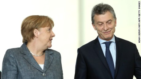Argentinian President Mauricio Macri (R) arrives with German Chancellor Angela Merkel for a joint press conference at the Chancellery in Berlin on July 5, 2016.  / AFP / Adam BERRY        (Photo credit should read ADAM BERRY/AFP/Getty Images)