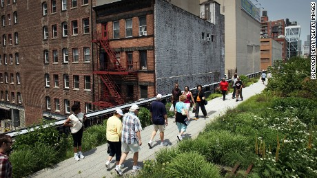 People walk along a path on the newly-opened second section of the High Line park in on June 7, 2011 in New York City. T