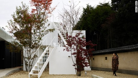This house designed by Sou Fujimoto mirrors a porous mountain. Large trees dwarf small minimalist blocks.