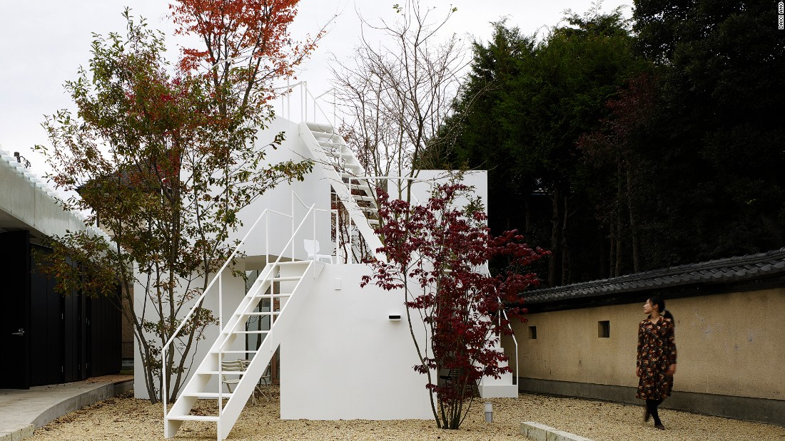 "This house designed by Sou Fujimoto mirrors that of a porous mountain. Large trees dwarf small minimalist blocks. Fujimoto has said, ""It is a really fundamental question -- how architecture is different from nature, or how architecture could be part of nature."""