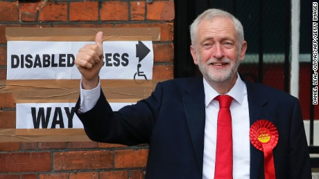 Britain's main opposition Labour Party leader Jeremy Corbyn arrives at a polling station to cast his vote in north London on June 8, 2017, as Britain holds a general election.