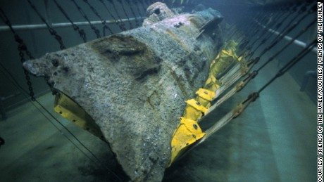 More clues of the H.L. Hunley mystery are being revealed during conservation of the American Civil War submarine. Researchers in a North Charleston, South Carolina, laboratory on Wednesday June 7, 2017 unveiled the crew compartment -- which had been sealed by more than 130 years of ocean exposure and encrusted sediment.