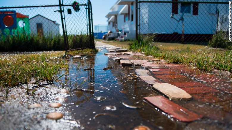 "Sea water collects in front of a home in Tangier, Virginia, in May 2017. Tangier Island in Chesapeake Bay has lost two-thirds of its landmass since 1850. Now, the 1.2 square mile island is suffering from floods and erosion and is slowly sinking. A <a href=""https://www.nature.com/articles/srep17890"" target=""_blank"">paper</a> published in the journal Scientific Reports states that ""the citizens of Tangier may become among the first climate change refugees in the continental USA."""