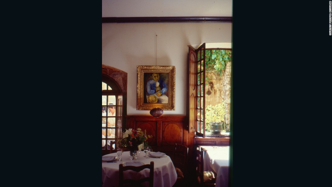 A painting by Pierre Tal-Coat hanging in the dining room.