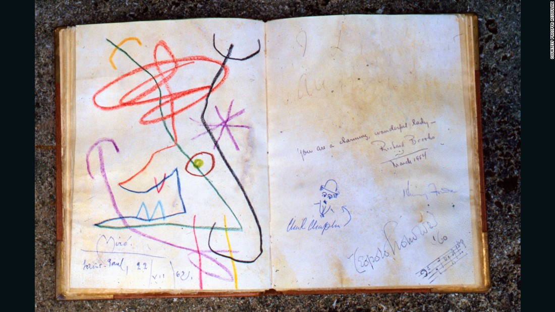 The guest books plays out like a who's who of the 20th century. On one page, the surreal workings of Joan Miro, on the other a caricature from Charlie Chaplin.