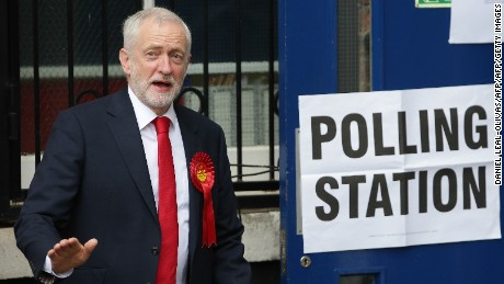 Britain's main opposition Labour Party leader Jeremy Corbyn leaves a polling station after casting his vote.