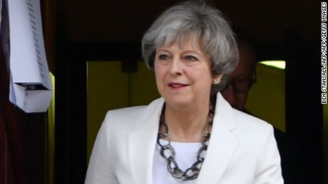 Britain's Prime Minister Theresa May leaves a polling station after casting her ballot paper in Sonning, west of London, on June 8, 2017, as Britain holds a general election. As polling stations across Britain open on Thursday, opinion polls show the outcome of the general election could be a lot tighter than had been predicted when Prime Minister Theresa May announced the vote six weeks ago. / AFP PHOTO / BEN STANSALL        (Photo credit should read BEN STANSALL/AFP/Getty Images)