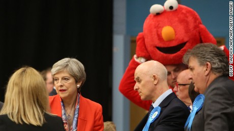 British Prime Minister Theresa May (2nd L) waits for the results to be declared at the count centre in Maidenhead early in the morning of June 9, 2017, hours after the polls closed in Britain's general election.   Prime Minister Theresa May is poised to win Britain's snap election but lose her parliamentary majority, a shock exit poll suggested on June 8, in what would be a major blow for her leadership as Brexit talks loom. The Conservatives were set to win 314 seats, followed by Labour on 266, the Scottish National Party on 34 and the Liberal Democrats on 14, the poll for the BBC, Sky and ITV showed. / AFP PHOTO / Geoff CADDICK        (Photo credit should read GEOFF CADDICK/AFP/Getty Images)
